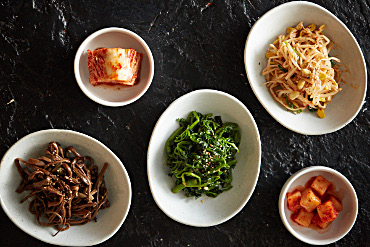 Bowls of Korean side dishes